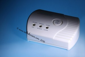 carbon monoxide detector on blue background